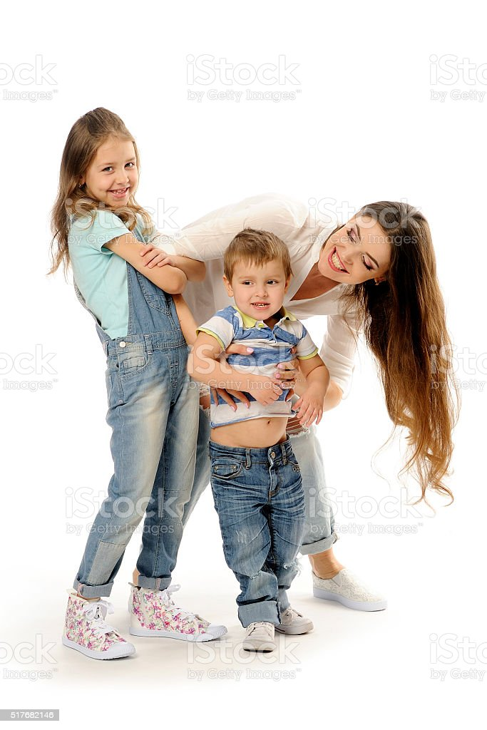 Happy family, joy, son, mother and her daughter, blue jeans. stock photo