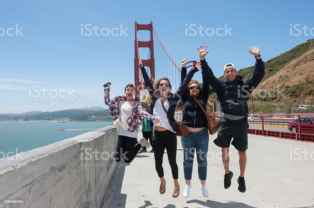 Happy Family Jumping for Joy stock photo