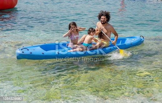 Happy family kayaking at sea, Kaş, Antalya, Turkey