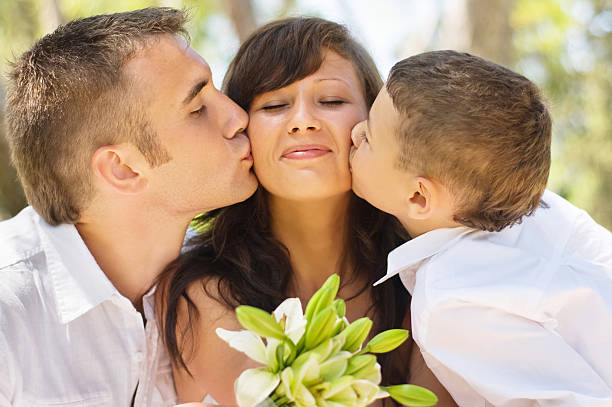 Happy family kissing. stock photo