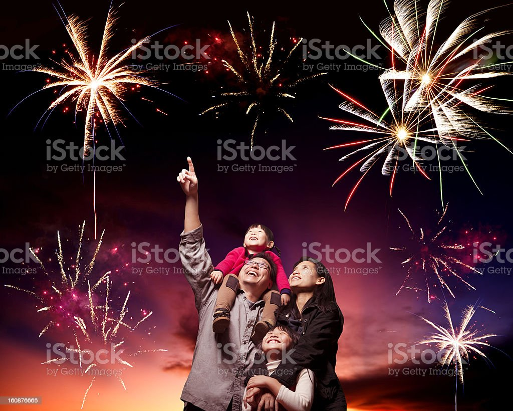 happy family looking fireworks stock photo