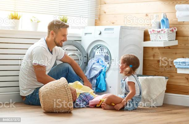 Happy family man father householder and child in laundry with washing picture id846037370?b=1&k=6&m=846037370&s=612x612&h=yyg6cmyy0zb1ucbcj3rrfnvo0yi4jcrvvhu6f1fo7yg=