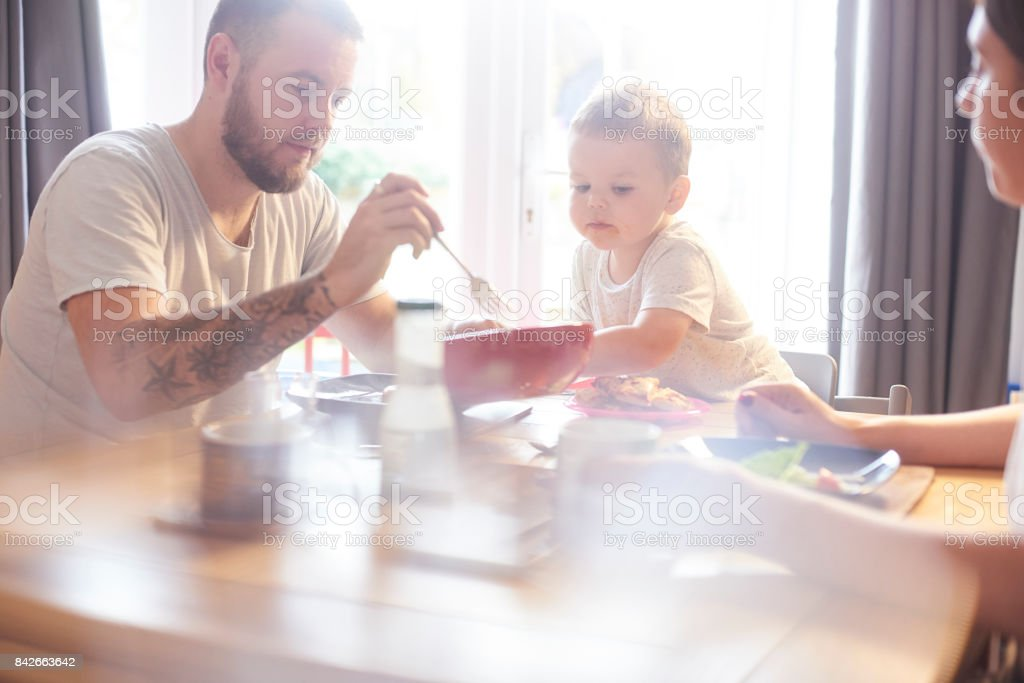 Happy Family meal time stock photo