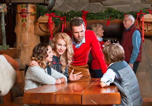 Happy Family Meeting At Christmas Time Stock Photo - Download Image Now