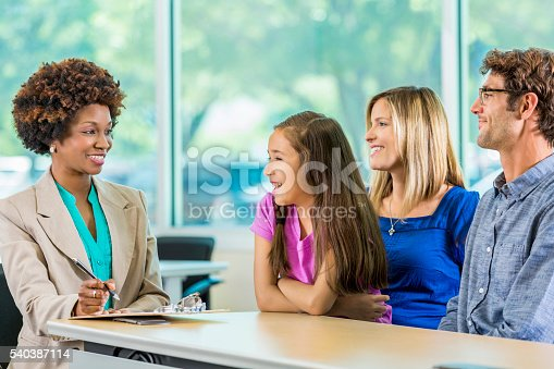 istock Happy family meeting with African American Teacher 540387114