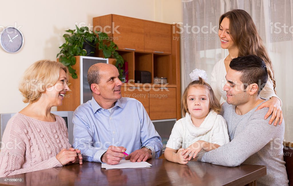 Happy family members ready to sign banking documents stock photo