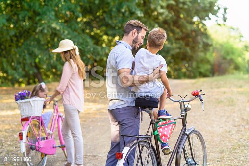 658444674istockphoto Happy family moment in the park 811961160