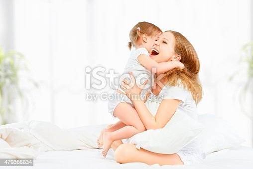 538360916 istock photo happy family mother and baby daughter playing and laughing baby 479366634