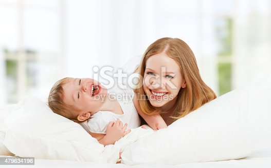 538360916 istock photo happy family mother and baby daughter playing and laughing baby 479634196