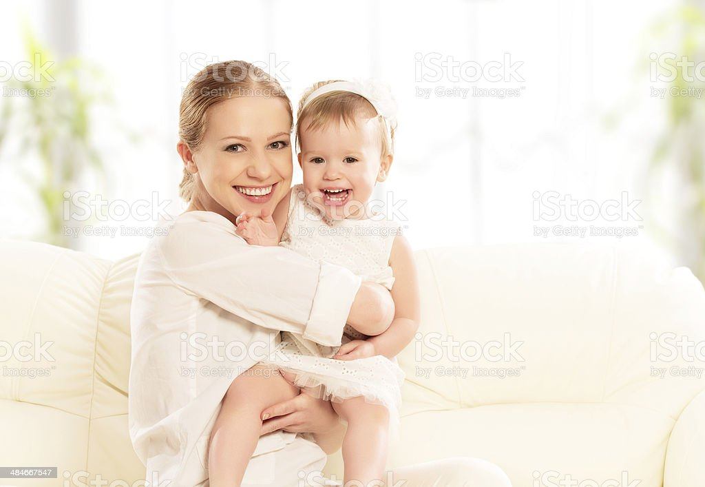 happy family. Mother and baby daughter plays, hugging, kissing royalty-free stock photo