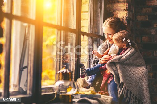 istock happy family mother and baby in autumn window 840266514