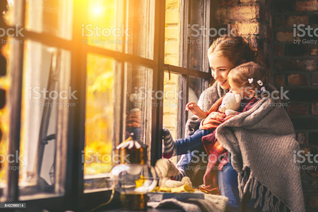 happy family mother and baby in autumn window stock photo