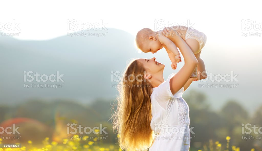 Happy family mother and baby son in  nature in summer stock photo