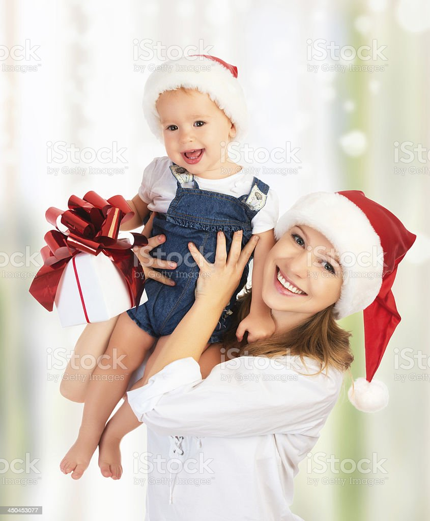 happy family mother and baby with gift  in Christmas hats royalty-free stock photo