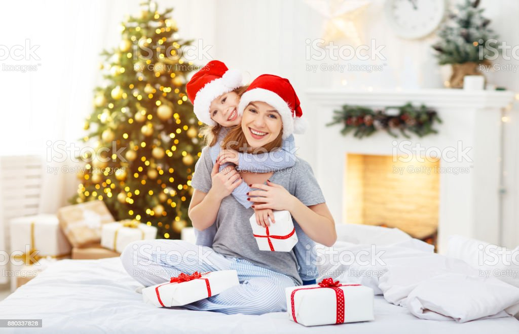 Happy Family Mother And Child Hugging Giving Gifts On Christmas Morning Royalty Free Stock
