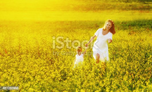 istock happy family, mother and child  little daughter on meadow 481060966