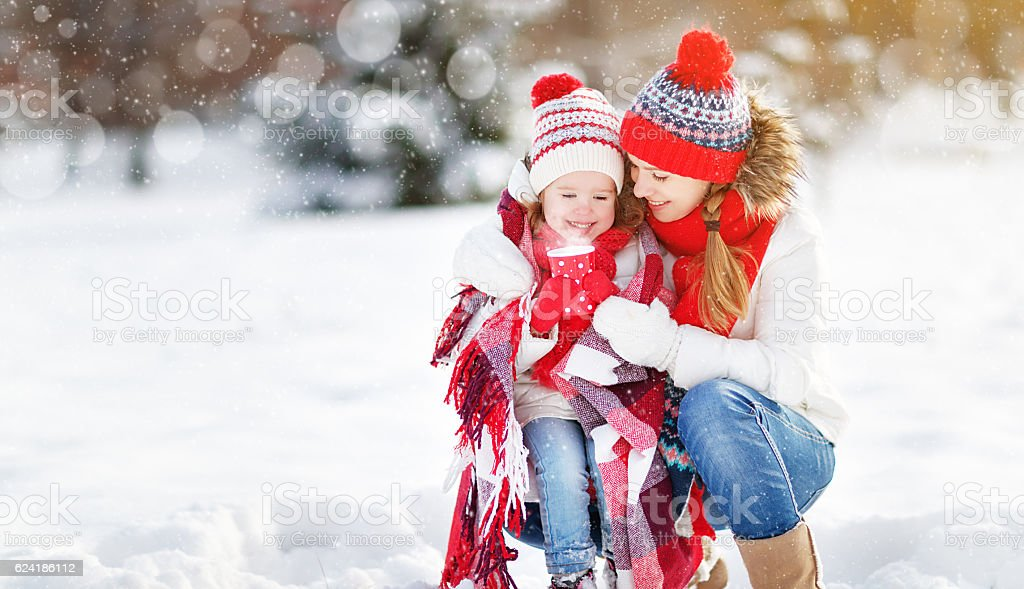 happy family mother and child on winter walk drinking tea stock photo