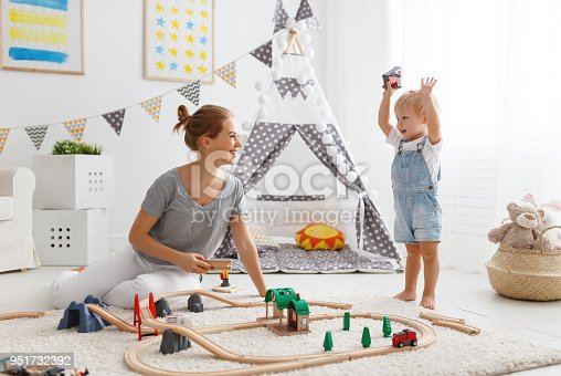 istock happy family mother and child son playing   in toy railway in playroom 951732392