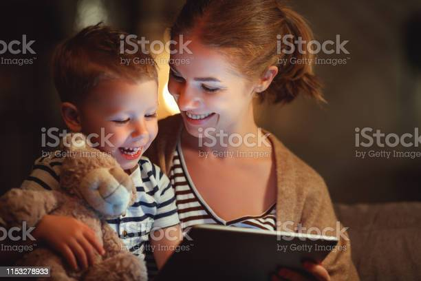 Happy family mother and child son with tablet in evening picture id1153278933?b=1&k=6&m=1153278933&s=612x612&h=qvjpeurgxjnn8rvnrard0yhfuhlf0azapavl9hw5v8w=