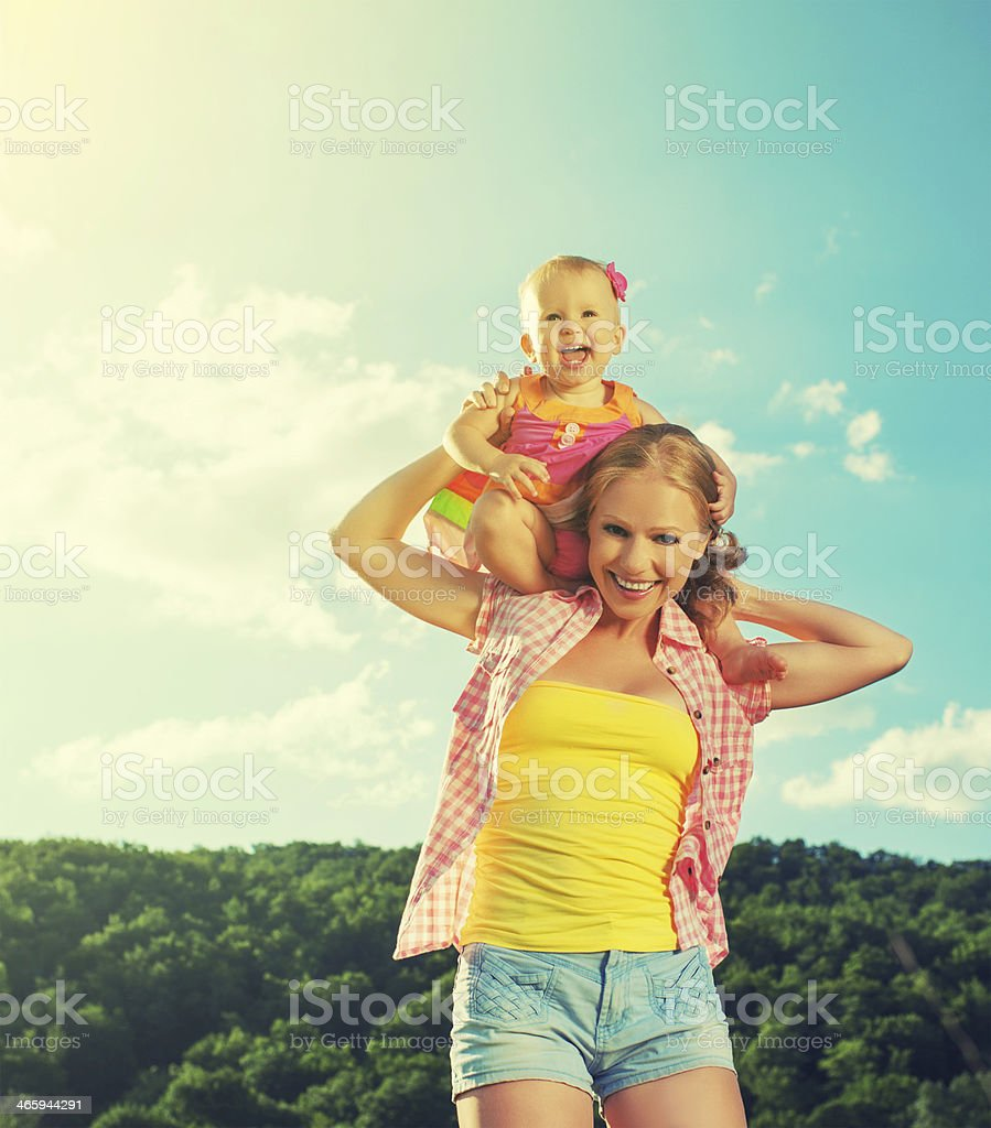 happy family. mother and daughter baby girl playing on nature royalty-free stock photo