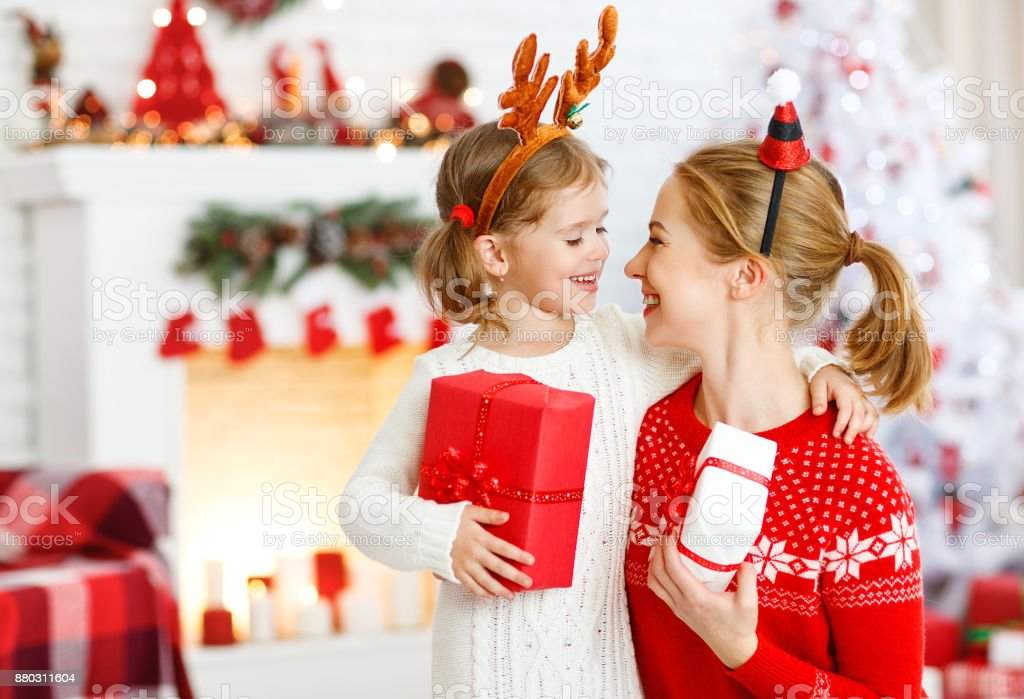 Family Christmas Gift Giving.Happy Family Mother And Daughter Giving Christmas Gift Stock