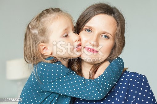 Happy family. Mother and little daughter hugging. Happy mother's day concept