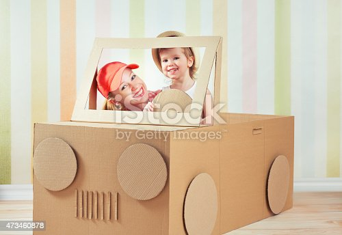 496487362 istock photo Happy family mother and little daughter ride on toy car 473460878