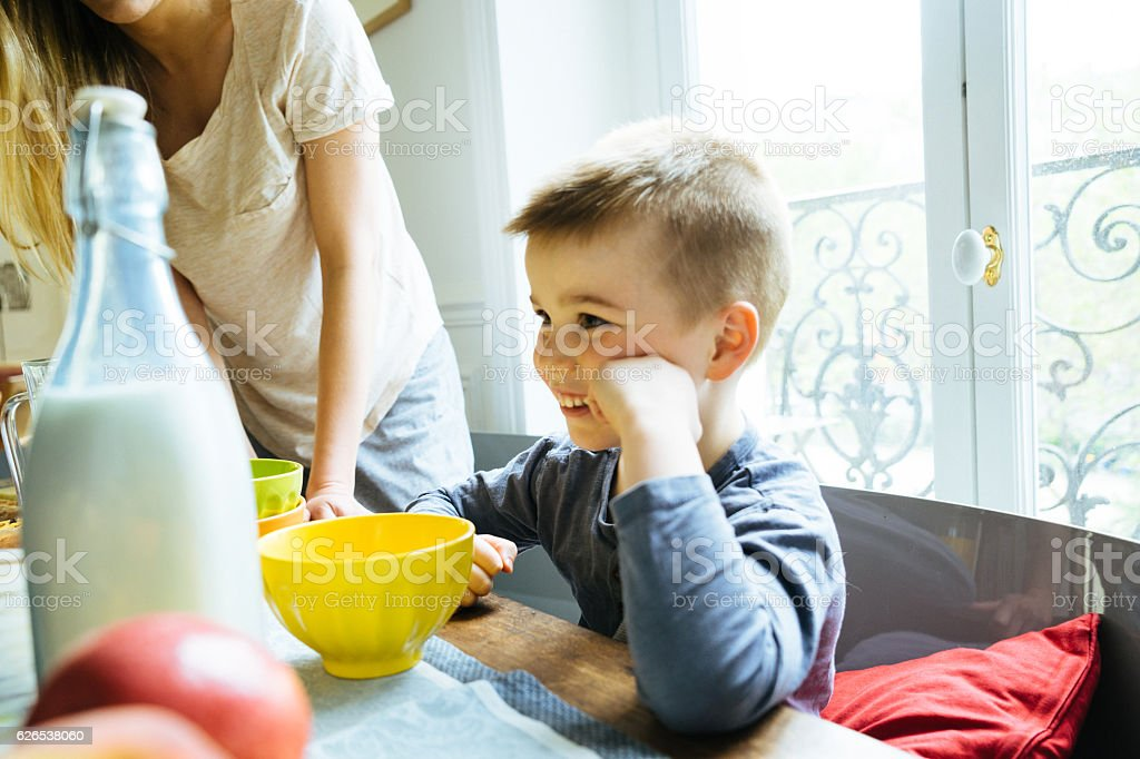 Happy Family, Mother And Son, Having Breakfast Together At Home stock photo