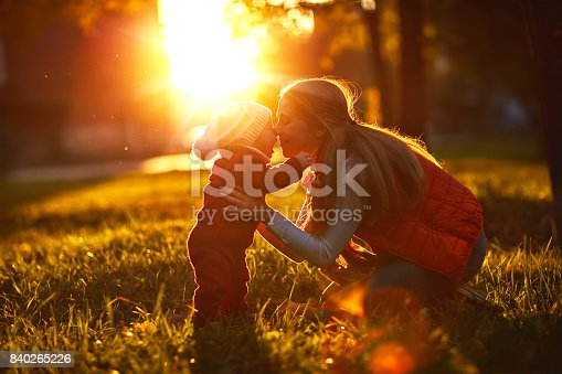 istock Happy family mother and toddler outdoors in park 840265226