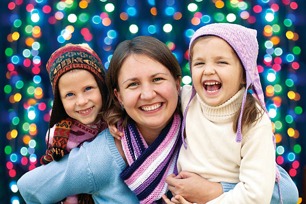 happy family mother and two little daughter stock photo