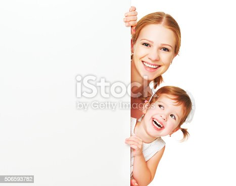 519837800 istock photo happy family mother child daughter with blank white poster 506593782