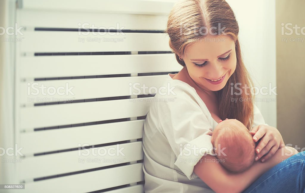 happy family. mother embracing newborn baby stock photo