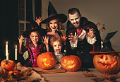istock happy family mother father and children in costumes and makeup on  Halloween 1176427133