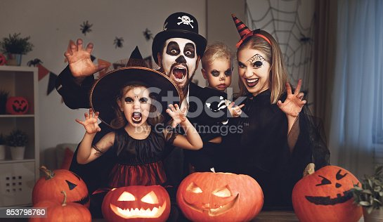 istock happy family mother father and children in costumes and makeup on  Halloween 853798760