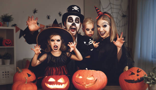 happy family mother father and children in costumes and makeup on  Halloween happy family mother father and children in costumes and makeup on a celebration of Halloween costume stock pictures, royalty-free photos & images