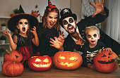 istock happy family mother father and children in costumes and makeup on  Halloween 854273850