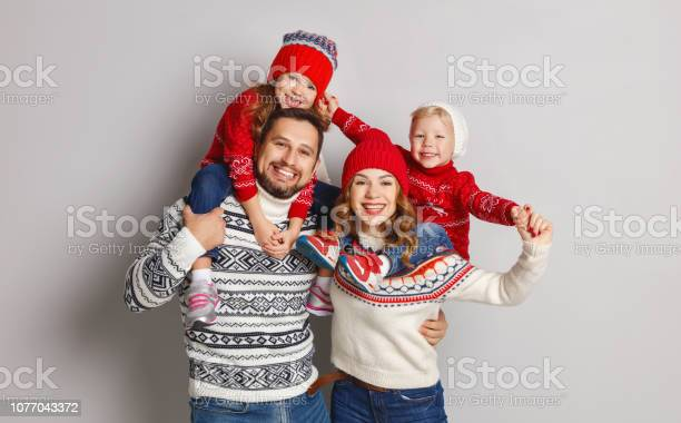 Happy family mother father and children in knitted hats and sweaters picture id1077043372?b=1&k=6&m=1077043372&s=612x612&h=5ihkrr 2ohy3rjv t5an6jnxmaqpzltpp0em27mperc=