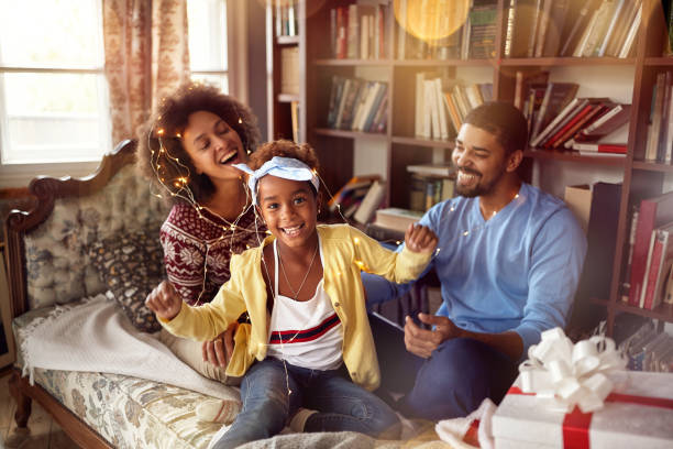 happy family – mother, father and little daughter playing together for the Christmas holidays stock photo