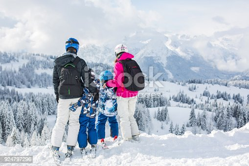 istock Happy family, mother, father and two children, skiing 924797296