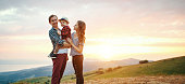 istock Happy family: mother, father, child  son a  on sunset 1208236511