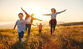 istock Happy family: mother, father, children son and daughter on sunset 1128746395