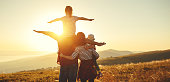 istock Happy family: mother, father, children son and daughter on sunset 1128746408