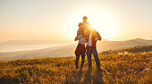 istock Happy family: mother, father, children son and daughter on sunset 1136686902