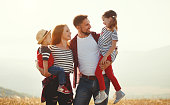 istock Happy family: mother, father, children son and daughter on sunset 1138494499