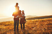 istock Happy family: mother, father, children son and daughter on sunset 1138494565