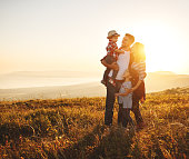 istock Happy family: mother, father, children son and daughter on sunset 1146213184