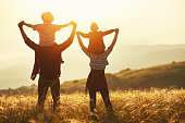 istock Happy family: mother, father, children son and daughter on sunset 1156678265
