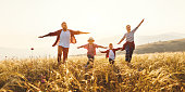 istock Happy family: mother, father, children son and daughter on sunset 1161951903