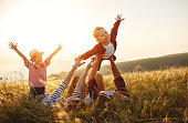 istock Happy family: mother, father, children son and daughter on sunset 1168998384