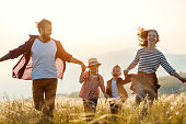 istock Happy family: mother, father, children son and daughter on sunset 1170259116